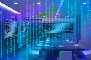 Zu sehen ist im Vordergrund ein Binärcode in bläulichen Farben, im Hintergrund ist ein Konferenzraum hinterlegt. Eine BSI-Warnung besagt, dass sich Trojaner immer häufiger an Unternehmen richten. Bild: pixabay.de/geralt