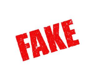 """Zu sehen ist der Schriftzug """"Fake"""" in der Art eines Stempel-Drucks. Die Corona-Weihnachtsbonus-Mail ist so ein Fake. Bild: Pixabay/Pete Linforth"""